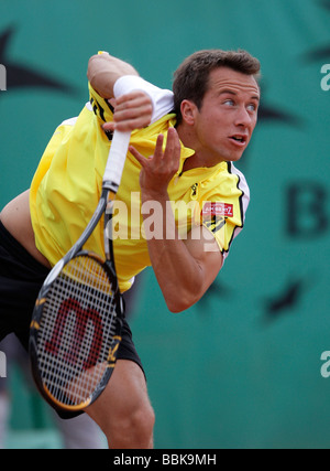 Tennis player Philipp Kohlschreiber playing a service at Roland Garros - Stock Photo
