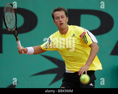 German player Philipp Kohlschreiber plays forehand return at Roland Garros - Stock Photo