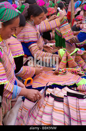 Flower H'mong women at Can Cao Market near Sapa in North Vietnam - Stock Photo