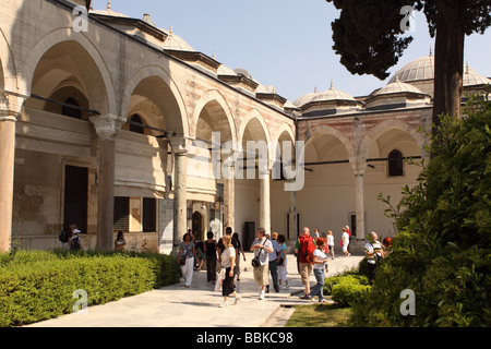 Istanbul Turkey tourists visit the Third Courtyard gardens at the Topkapi Palace - Stock Photo
