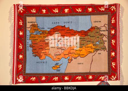 Turkish map on carpet on wall in carpet factory, Denizli, Denizli Province, Turkey Stock Photo