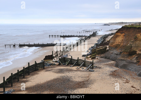 Sea defences and coastal erosion, Norfolk coast, England - Stock Photo
