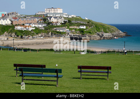 Park benches on a green overlooking Towan beach and the harbour in Newquay, Cornwall UK. - Stock Photo