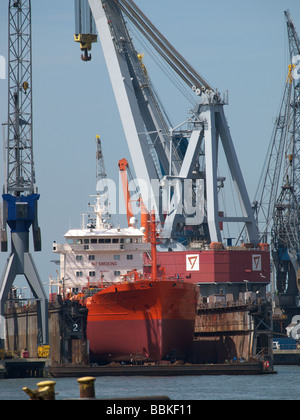 Ship in dry dock for maintenance below the waterline Rotterdam port area Zuid Holland the Netherlands - Stock Photo