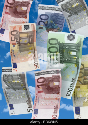 Banknotes raining down from the sky - Stock Photo