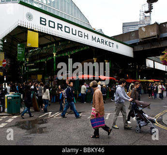 People shopping at Borough Market in London.  Photo by Gordon Scammell - Stock Photo