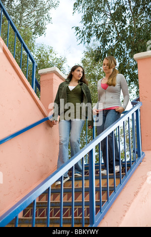 young person people Racially mixed mix Ethnic diversity hang hanging out together take stairs friend friends serious - Stock Photo
