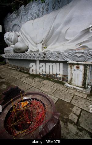 The reclining buddha at long son pagoda - Stock Photo