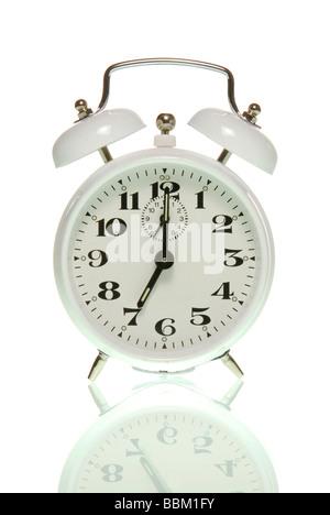 Alarm clock showing seven o'clock - Stock Photo