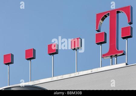 Deutsche Telekom-logo on the building of the corporate headquarters, Bonn, North Rhine-Westphalia, Germany, Europe - Stock Photo