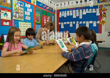 Elementary kids reading interracial multi ethnic racial diversity racially diverse multicultural multi cultural - Stock Photo