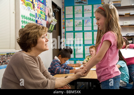 5-6 year old student students teacher talking to girl MR face to face eye contact     © Myrleen Pearson - Stock Photo