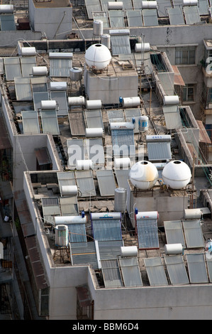 CHINA Solar panels installed on roofs of apartment buildings and offices in Kunming Yunnan province Photo by Julio - Stock Photo
