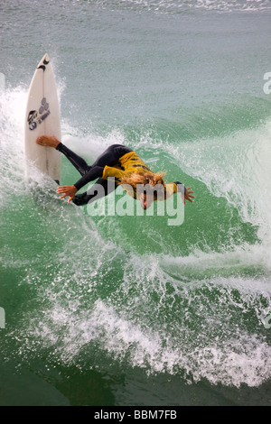 Rob Machado competing in the Katin Pro Am surf competition at Huntington Beach Pier Orange County California - Stock Photo