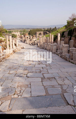 Ancient marble highway leading through Ephesus in Turkey - Stock Photo