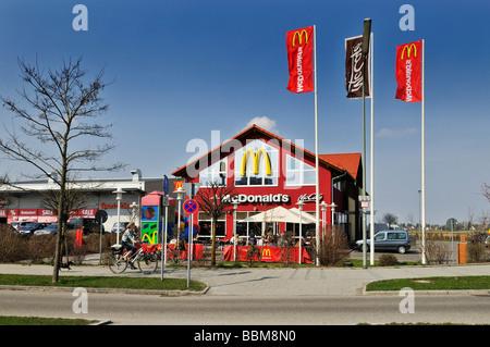 Mc Donald's Mc Cafe, flags, Munich, Bavaria, Germany, Europe - Stock Photo