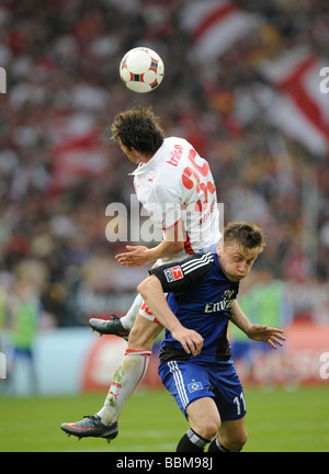 Tackling, Christian Traesch, German footballer playing for VfB Stuttgart, above, versus Ivica Olic, playing for - Stock Photo