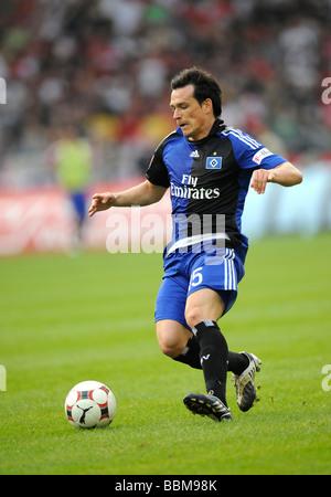 International Piotr Trochowski, German footballer playing for HSV, Hamburger SV, on the ball - Stock Photo