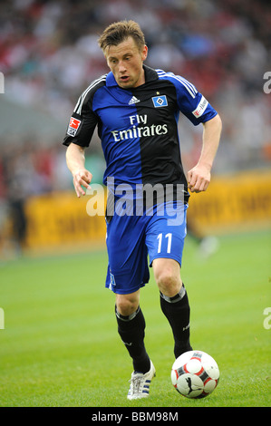 Ivica Olic, German footballer playing for HSV, Hamburger SV, on the ballv - Stock Photo
