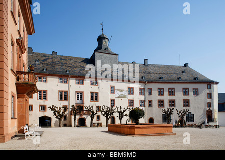 Castle square with fountain and the north wing, Berleburg Castle, Bad Berleburg, district of Siegen-Wittgenstein, - Stock Photo