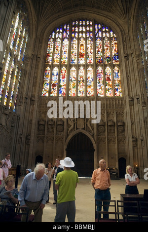 Tourists admire the Stained Glass windows, West face, Kings College Chapel, Cambridge UK - Stock Photo