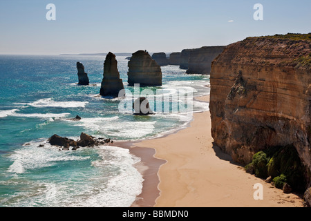 Australia, Victoria. Some of the Twelve Apostles standing in shallow water in the Port Campbell National Park. - Stock Photo