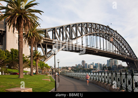 Australia New South Wales. Early morning jogger at Sydney Harbour Bridge. - Stock Photo