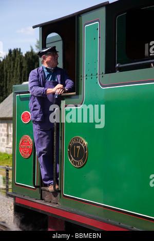 Driver on the footplae of the Strathspey Restored Steam Railway, Aviemore,  Boat of Garten steam railway station - Stock Photo