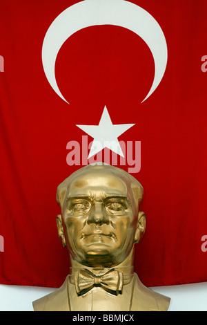 Golden bust of Mustafa Kemal Atatuerk in front of Turkish flag, Istanbul, Turkey - Stock Photo