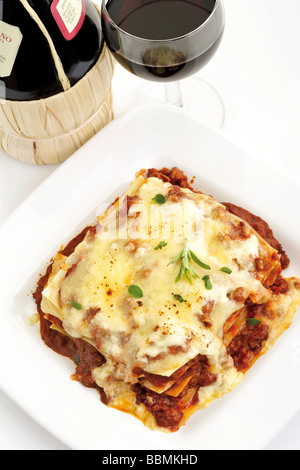 Lasagna with red wine - Stock Photo