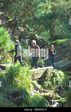 Family walking in Ecclesbourne Glen Hastings Country Park Hastings East Sussex England - Stock Photo