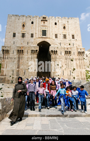 School class in front of the citadel, Aleppo, Syria, Middle East, Asia - Stock Photo