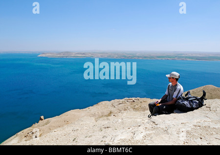 Hikers on the mountain Jebel Arruda, in the back the Asad reservoir of the Euphrates, Syria, Asia - Stock Photo
