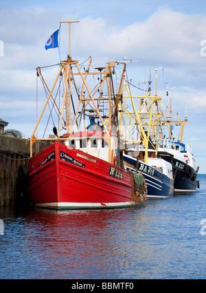 Three fishing boats tied up in Girvan harbour, Ayrshire, Scotland, UK. - Stock Photo