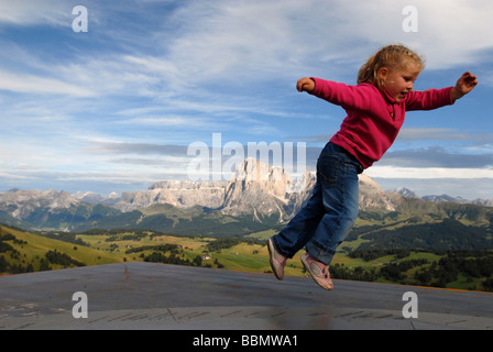 Summertime on the Alpe di Siusi: little girl playing, South Tirol, Italy - Stock Photo