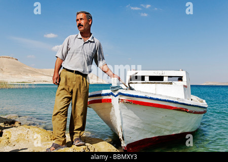 Fisherman with boat on the Asad reservoir of the Euphrates, Syria, Asia - Stock Photo