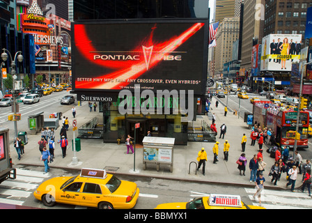 Advertising for General Motors Pontiac brand is seen in Times Square - Stock Photo