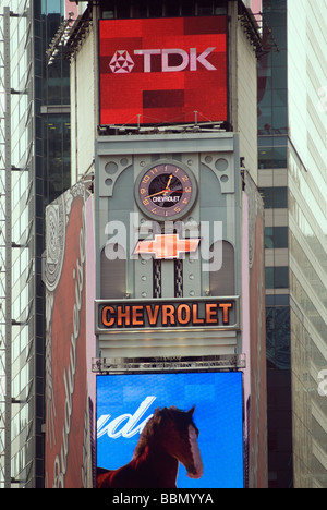 Advertising for General Motors Chevrolet brand is seen in Times Square - Stock Photo
