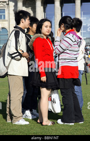 Asian tourists in front of Reichstag, Berlin, Germany - Stock Photo