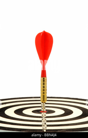 Red dart hit the target, a symbolic image for a direct hit - Stock Photo