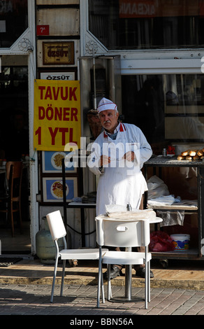 Chef in front of his diner, waiting for guests, sign chicken kebab 1 YTL, Karakoey, Istanbul, Turkey - Stock Photo