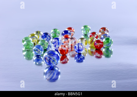 Many colourful marbles on a reflective surface for a background use - Stock Photo