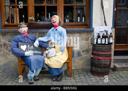 Figures in front of a wine shop in the old town of Bacharch, Unesco World Heritage Upper Middle Rhine Valley, Bacharach, - Stock Photo