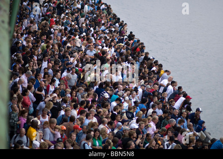 Large crowds gather near the East River on FDR Drive in New York City for July 4th Macy's fireworks show,. © Craig - Stock Photo