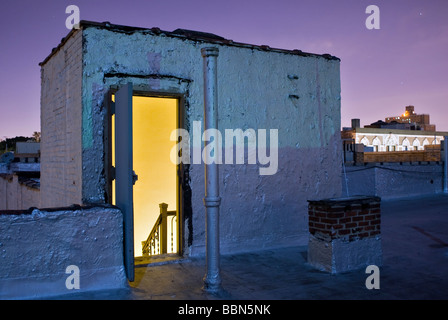 Apartment building rooftop in Harlem, New York City during a full moon. © Craig M. Eisenberg - Stock Photo