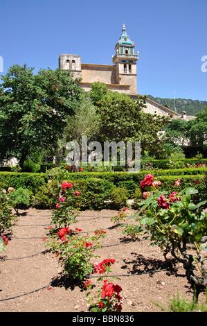 The Carthusian monastery from gardens, Valldemossa, Valldemossa Municipality, Mallorca, Balearic Islands, Spain - Stock Photo