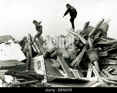 geography / travel, Germany, reunification, fall of the Berlin Wall, children jumping on the debris of the Wall, - Stock Photo