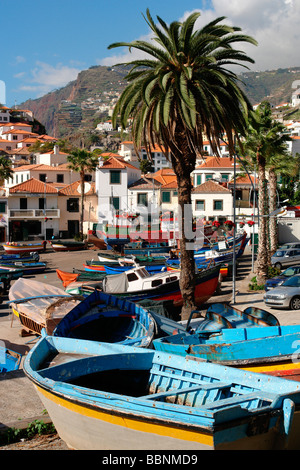 geography / travel, Portugal, Madeira, Camara de Lobos, Old (fishing) boats on shore in front of the small town, - Stock Photo