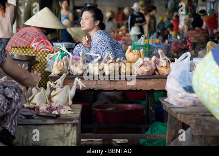 Hoi An,Vietnam;Vendors selling at an open air market - Stock Photo
