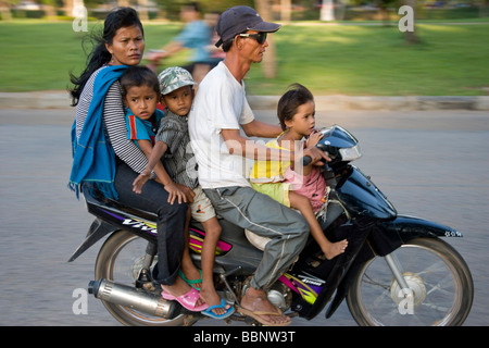 Siem Reap,Cambodia;Family riding on a scooter together without safety helmets - Stock Photo